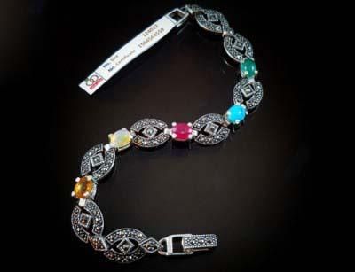 دستبند نقره با سنگ های قیمتی یاقوت، زمرد، اوپال و فیروزه